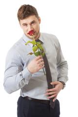 Handsome man holding red rose.