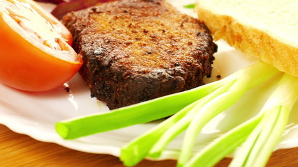 Grilled meat on a white plate
