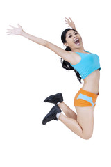 Sporty woman jumping over white