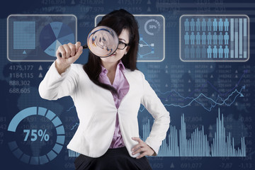 Worker with magnifier and financial background
