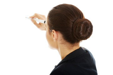 Young businesswoman writing with marker.