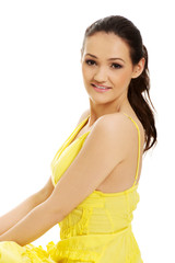 Beautiful female model in yellow dress.
