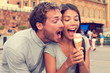 Funny playful young couple eating ice cream - 78562708