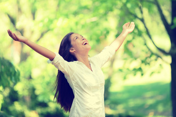 Freedom happy woman feeling free in nature air