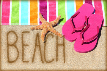 Beach vacation concept - word written in sand