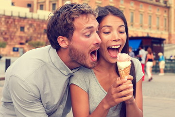Funny playful young couple eating ice cream