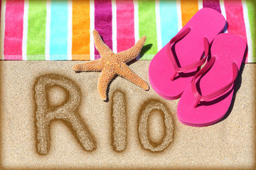 Rio beach vacation concept - flip flops and towel