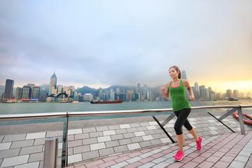 Sport woman jogging in Hong Kong city exercising