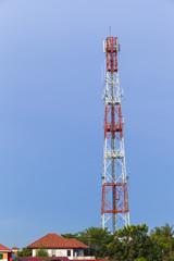 Telephone pole on blue sky background.