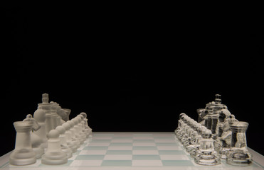 Glass chess board isolated on black