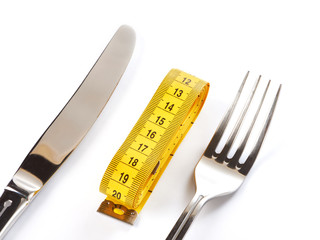 Yellow tailor meter, fork and knife isolated