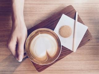 hand grabbing coffee
