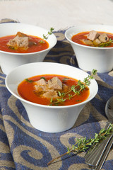 Tomato cream soup with tuna and thyme