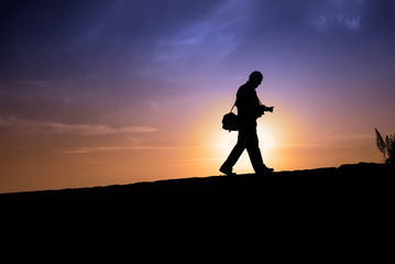 Silhouette of a man walking