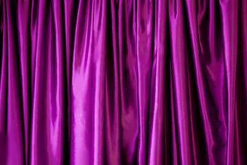 Lilac silk fabric in the fold. curtain