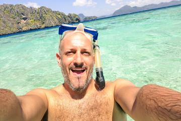Handsome man taking selfie at islands hopping at El Nido Palawan