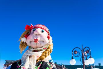 Scarecrow against the blue sky