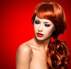 Beautiful  woman with long red hairs and bright eye makeup