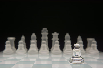 A pawn standing alone against the other team.
