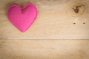 pink heart love symbol on wood background