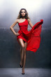 Young, beautiful and passionate woman in a red dress