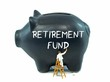 A piggy bank with the retirement fund theme on the side - 78566974