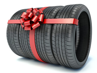 Tyres with a red ribbon. Present. 3D