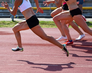 Women are running on the running track