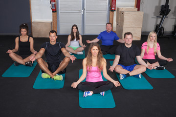 group of people preparing for sport exercise with yoga meditatio