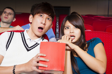 Young couple  watching a movie at the cinema
