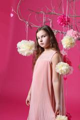 Весна - девочка на розовом фоне у цветущего дерева