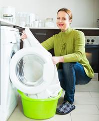 Brunette woman near washing machine