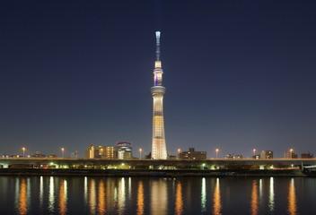View of Tokyo Skytree landmark and Sumida river at night