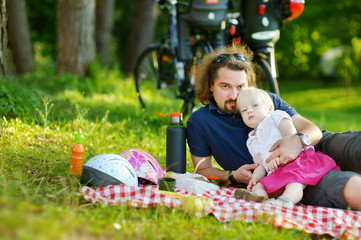 Young father and his daughter having a picnic