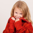 portrait of a cute little girl in red sweater