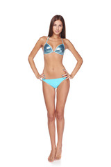 Full length beautiful slim woman in blue bikini