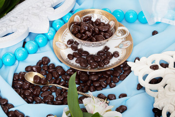 chocolate dragees in a still life blue colors