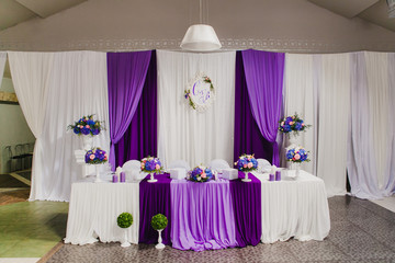 Head table for newlyweds at the wedding hall. Purple, violet