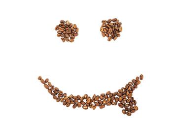 Grains of coffee in the form of smiling face isolated. coffee