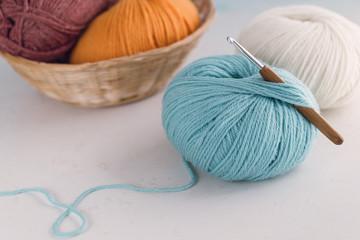 Ball of wool yarn with crochet hook