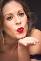 Beautiful  Woman giving an air kiss