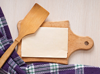 paper and wooden utensils for the kitchen, paper menu