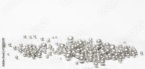 Pure silver granules on a white background