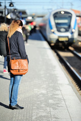 Woman waiting for incoming train
