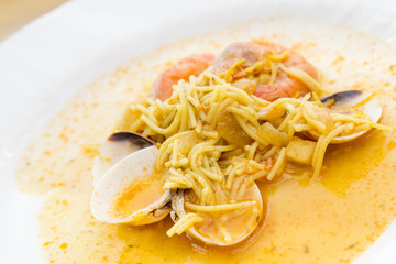 dish with seafood soup
