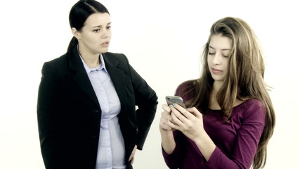 Mother getting angry with daughter playing with smart phone