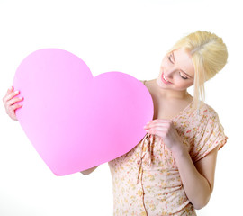Portrait of attractive happy smiling blonde teen girl with pink