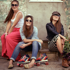 Girls having fun together outdoors, urban lifestyle, image toned