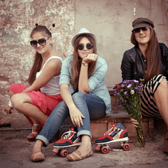 Girls having fun together outdoors, urban lifestyle, image filte