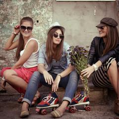 Girls having fun together outdoors, urban lifestyle